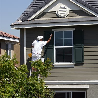 Painter finishing an exterior painting job